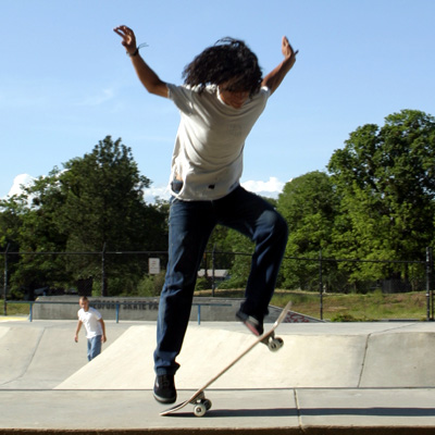 With your back foot, pop the board up as you would in an Ollie